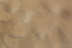 Sand on the beach. Surface of sand with small troughs Royalty Free Stock Images