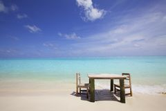 Sand Beach with Table and Chairs Royalty Free Stock Photos