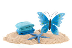 Towels and butterfly at the beach Stock Photos