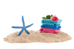 Towels and starfish at the beach Stock Image