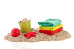 Towels and toys at the beach Royalty Free Stock Photos