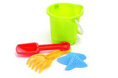 Sand / beach toy set: pail, shovel, rake and star-shaped mold. Closeup of a sand / beach toy set with a pail, shovel, rake and star-shaped mold of different Stock Photos