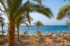 Sand beach of tropical hotel stock photos