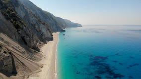 Sand beach under big mountain. Aerial shot stock footage