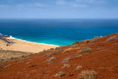 Sand beach under a red volcano. In Lanzarote, Canary Islands, Spain Royalty Free Stock Photo