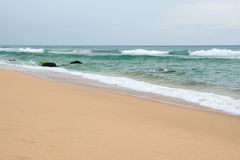 Sand beach Varkala India. At overcast day Royalty Free Stock Image