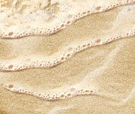 Sand beach water background Stock Photos