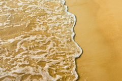 Sand beach and wave Stock Image