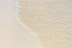 Sand beach, wave and sand. Summer concept. Sand beach and clear water royalty free stock images