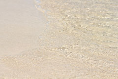 Sand beach, wave and sand. Summer concept. Sand beach and clear water royalty free stock photo