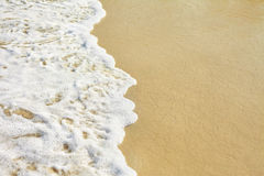 Sand beach and wave Royalty Free Stock Photos