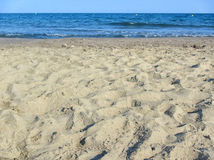 Sand beach, wave and sky. Sand beach and sea. Sunny day light Royalty Free Stock Image
