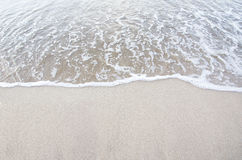 Sand beach with wave Stock Images