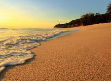 Sand beach and wave on sunrise Stock Photography