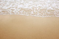 Sand beach and wave Royalty Free Stock Photo