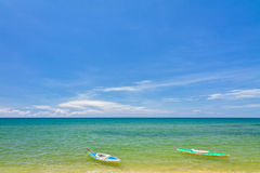 Sand Beach With Canoes In Phu Quoc Royalty Free Stock Photo