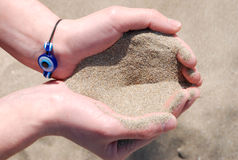 Sand in beautiful hands. Summer picture with sand in hands Royalty Free Stock Photos