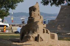 Sand bemannt Gesichtsskulptur in Kristiansand, Norwegen Stockbild