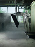 Sand blasting a metal Stock Photography