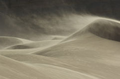 Sand blowing over sand dune in wind Royalty Free Stock Photo
