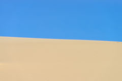 Sand and the blue sky Royalty Free Stock Images