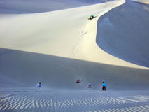 Sand boarding. Down sand dunes stock photos