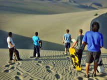 Sand boarding down dunes. Sand boarding down over dunes waiting to go down stock photography