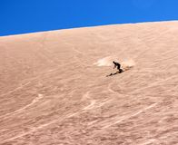 Sand Boarding on the dunes. In the Atacama Desert, Chile stock photography