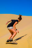 Sand-boarding fun on Atacama Desert, Oasis of Huacachina, Ica Region, Peru Royalty Free Stock Photos