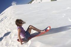 Sand boarding girl Stock Photo