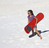 Sand boarding girl Stock Images