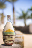 Colored sand bottle Stock Image