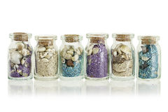 Sand in bottles. Little glass bottles with sand and seashells Stock Photography