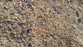 Sand, boulders and small rocks were black granules mixed with gravel. stock photo