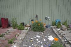 Sand box front yard flower garden Stock Photo