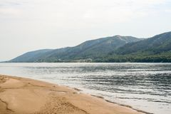A sand braid, Zhiguli mountains and the riverbed of the Volga river. A sand braid, green wooded Zhiguli mountains and the riverbed of the Volga river in hot Royalty Free Stock Photography