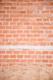 Sand and brick wall Royalty Free Stock Photos