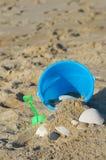 Sand and Bucket. Sand bucket on sand at the beach stock photo
