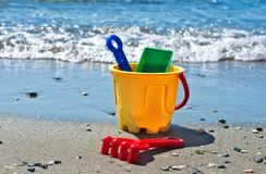 Sand bucket on the beach. Kids sand bucket and toys on the beach Stock Photography
