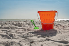 Sand bucket at the beach Royalty Free Stock Image