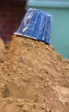 Sand and bucket on building site. Photo of upturned bucket on sand on building site Stock Photo