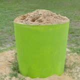 Close up sand bucket. Sand bucket discarded cigarette butts stock image