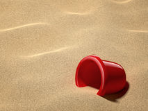 Sand Bucket. Red sand bucket on beach Stock Images