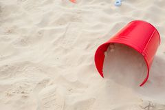 Red sand bucket at the seabeach. Sand bucket at the seabeach with space for text summer fun at sea concept stock photo