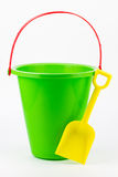 A sand bucket with a shovel. Stock Photography