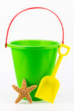 A sand bucket, shovel, and starfish. Stock Photos