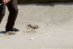 From the sand bunker. Golfer playing golf from the sand bunker Stock Image