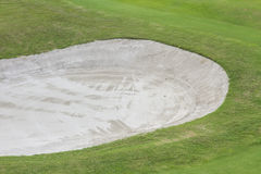 Sand bunker at the beautiful golf course. Royalty Free Stock Photos