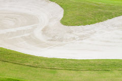Sand bunker at the beautiful golf course. Royalty Free Stock Images