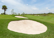 Sand bunker on the beautiful golf course Royalty Free Stock Photo